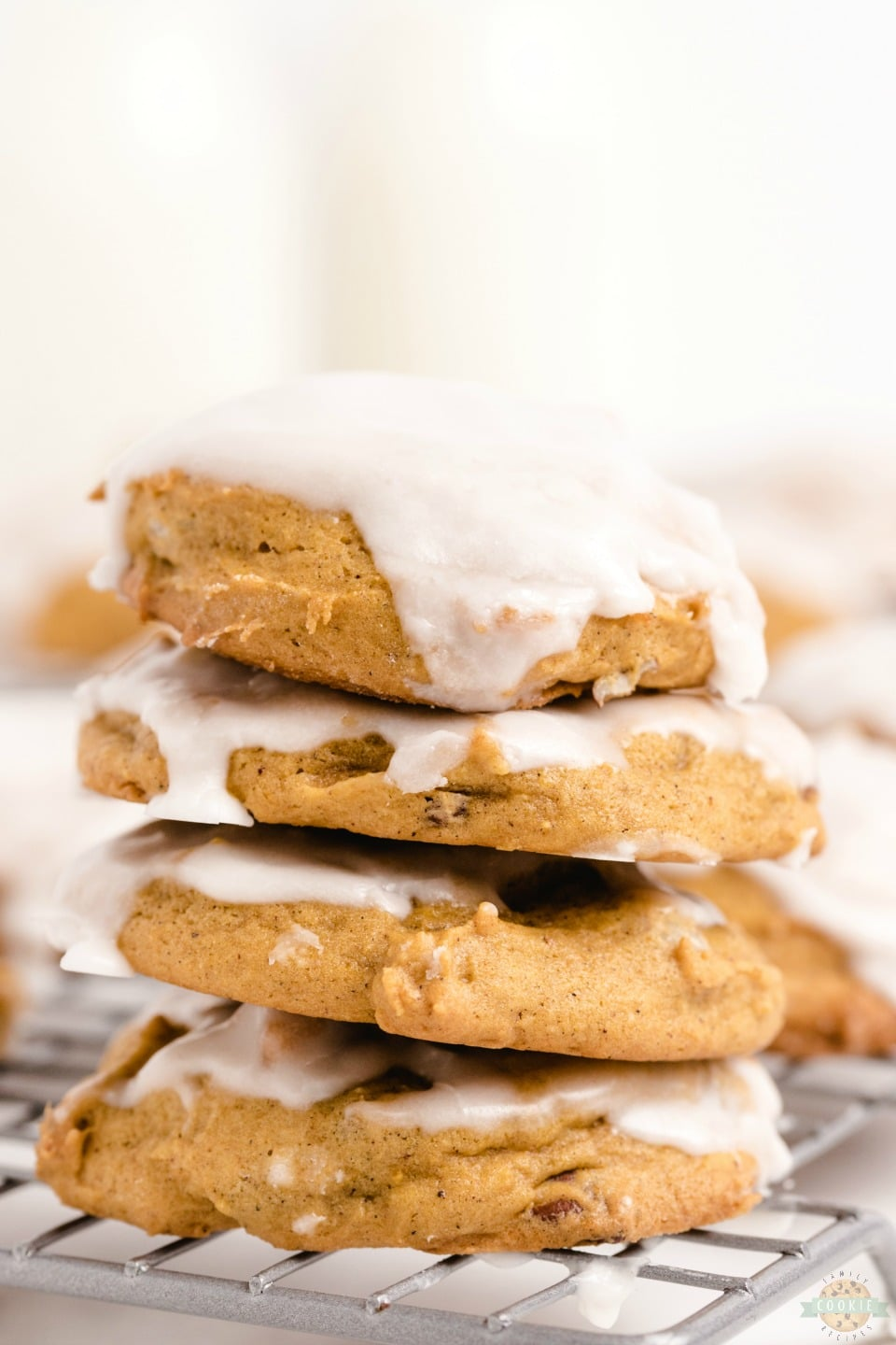 Iced Pumpkin Cookies are spiced with cinnamon, nutmeg & vanilla for a soft & sweet pumpkin dessert. These easy pillowy pumpkin cookies iced with smooth vanilla icing are perfect for pumpkin lovers!