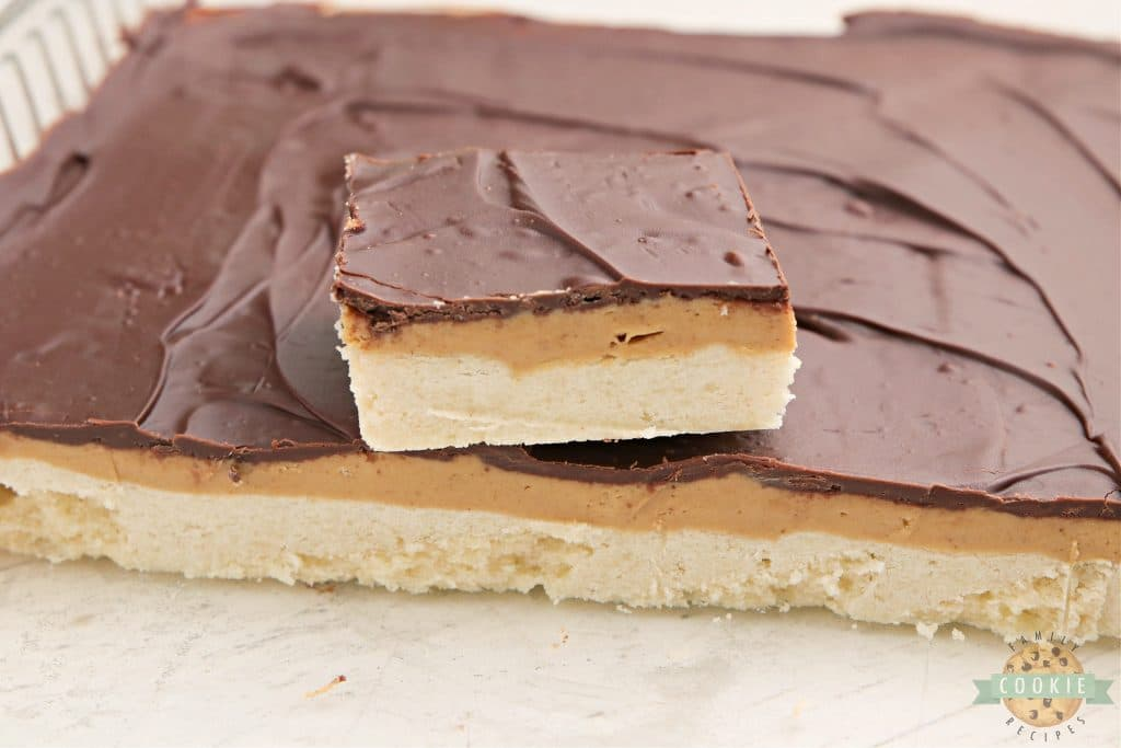 Cookie bars with a shortbread crust, a peanut layer and chocolate on top