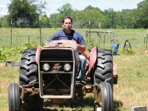 husband working on the tractor