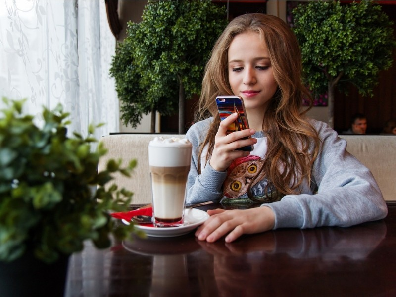 Teenage girl smartphone coffee cafe