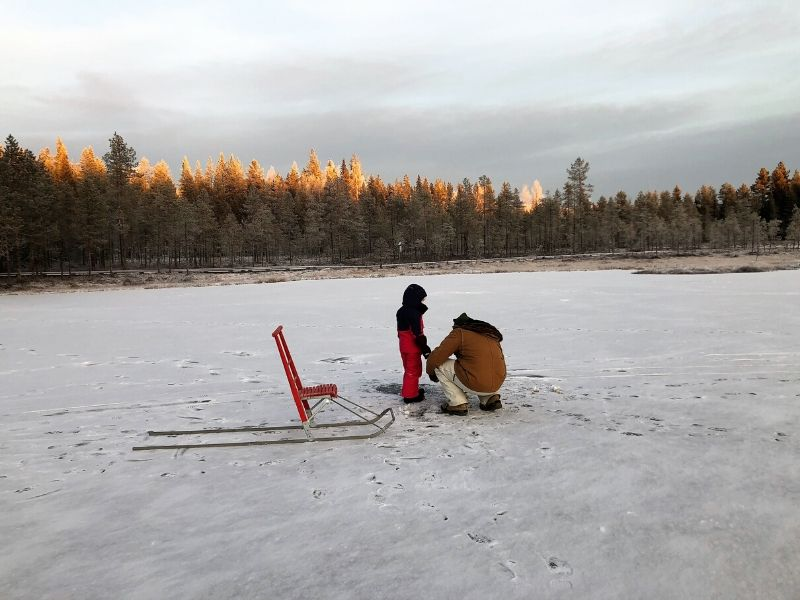 Ice fishing in Lapland Finland