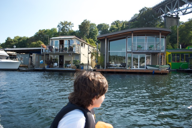 Paulo intrigued with the house-boats along the canal