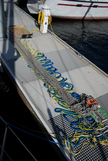 "First of all, i took the chain out of the drum and laid it on the dock for two purposes - visually check each and every link, and place a marker every 20ft, so that i know the length of chain paid out at anchorages (the other cables underneath the chain, i laid them there to act as a ""bedding"" to protect the chain from chaffing against the abrasive dock)."