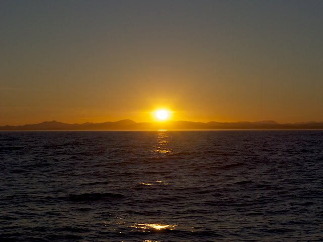 When the sun was up, Cape Flattery was already out of sight on our wake, and we were some 10 miles off the coast