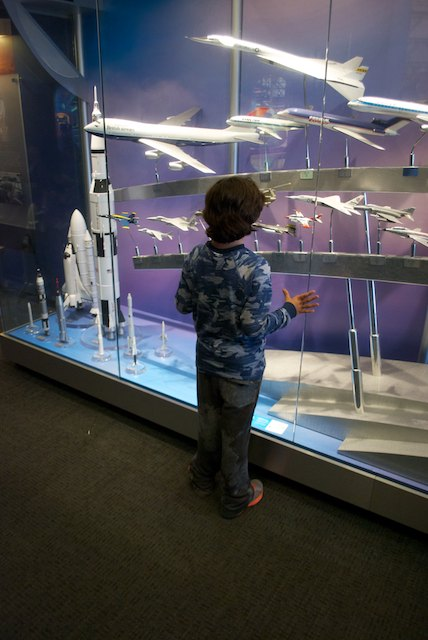Paulo 's imagination flying high at the gallery of Boeing's different airplane models (pun intended)