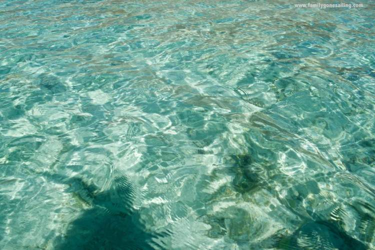 The clear water, and the brilliant sand below