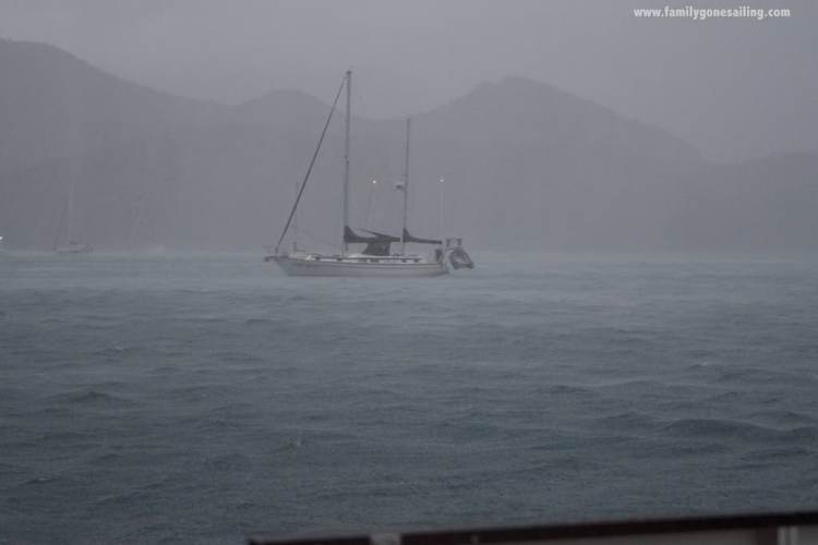 Heavy rainfall enveloping the boats in the bay