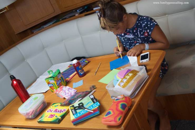 Raquel preparing a custom-made birthday card for Phil (s/v Coastal Drifter)