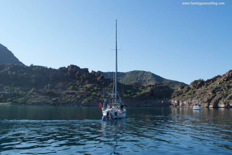 s/v Sarita, with Punta Cola de Ballena on the background