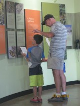 Daddy helping Owen answer some questions from his booklet.