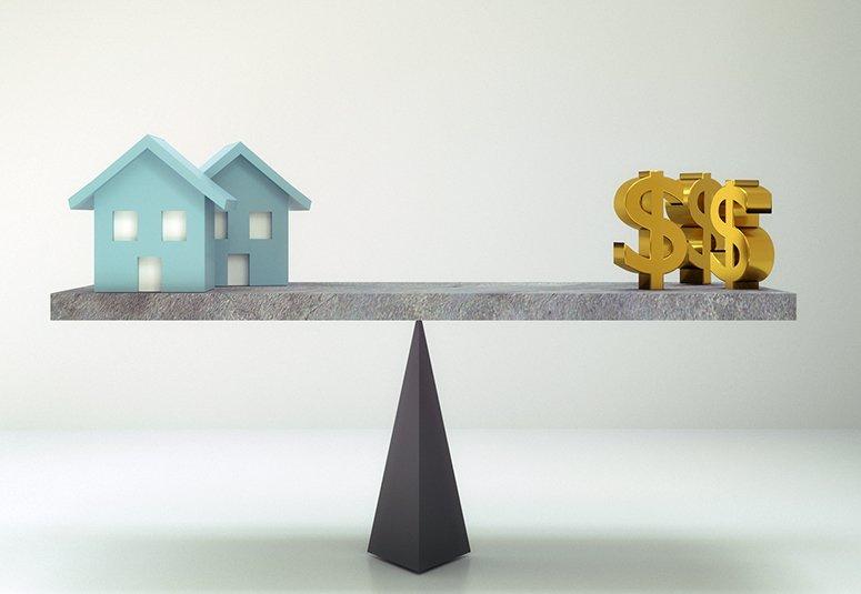 dollar sign and house on balance board