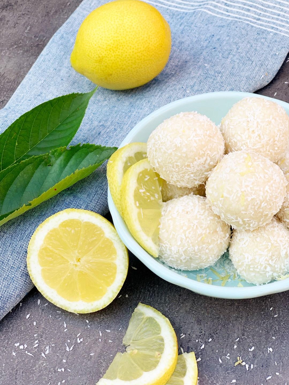 Picture of lemon keto energy balls and lemon slices