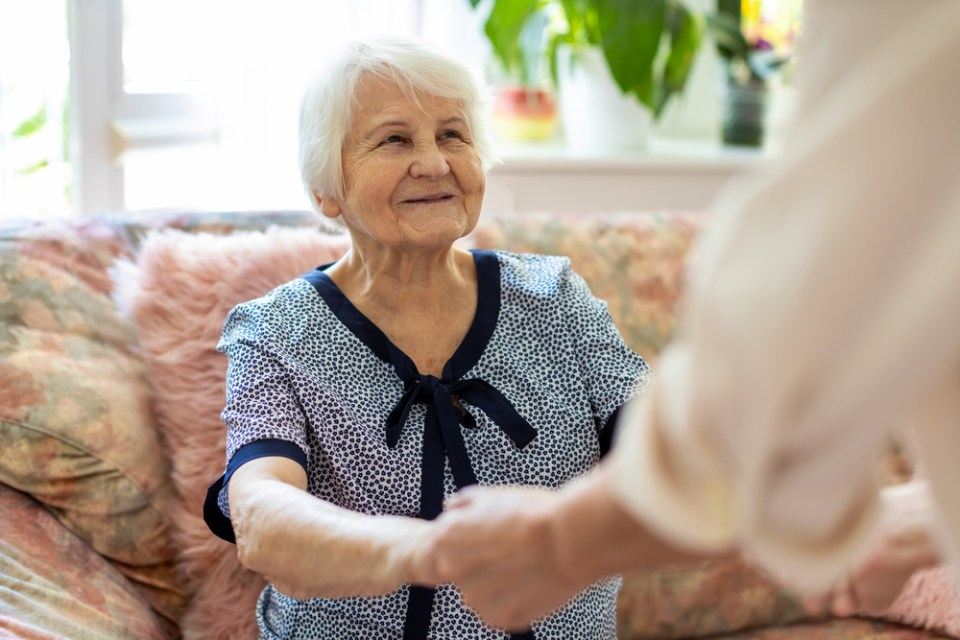 home caregiver assisting elderly woman