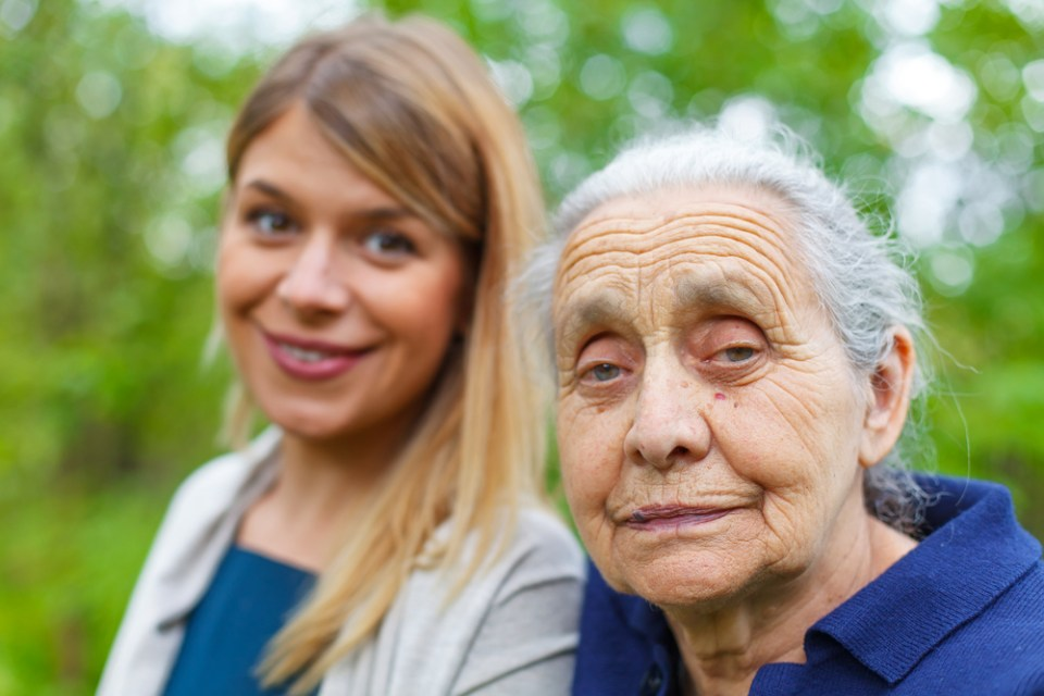 young woman cares for grandmother at home