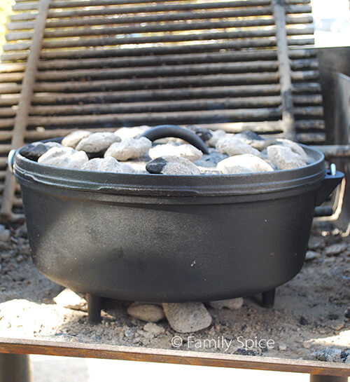 Dutch Oven with hot coals to learn How to Cook in a Dutch Oven - by FamilySpice.com