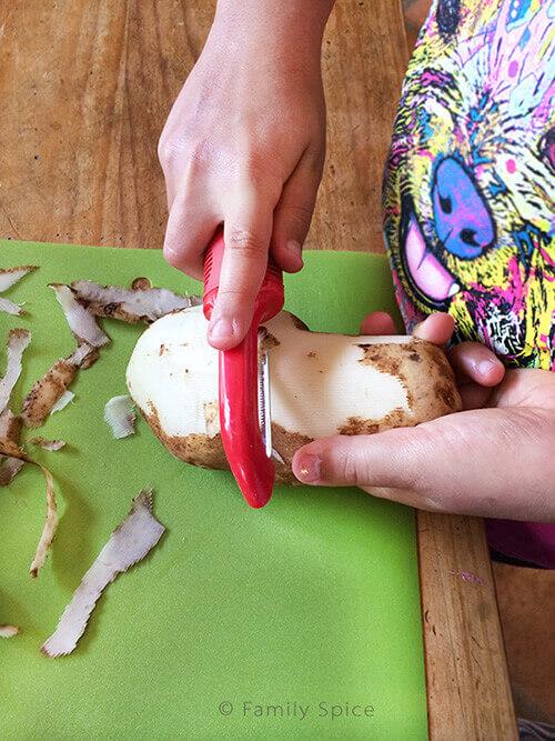 Peeling Potatoes for Campfire Carne Asada Fries by FamilySpice.com