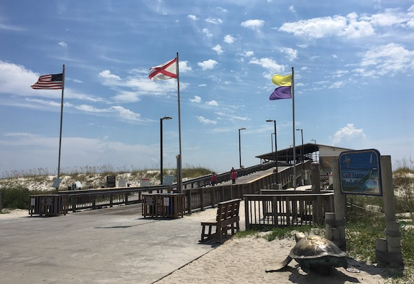 Photo of the flags at the entrance to the Gulf State Park Pier