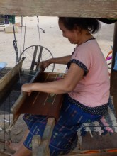 At work on the loom. The looms were in the village square so that the women could chat while they worked.