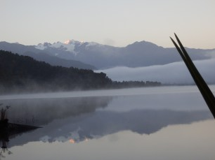 Misty lake with 2 x's Mt. Cook