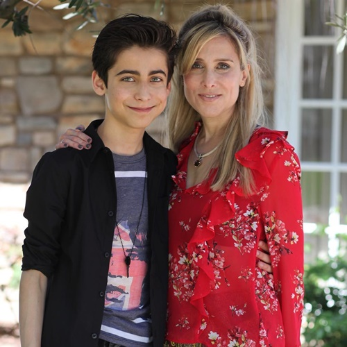Aidan Gallagher with his mother