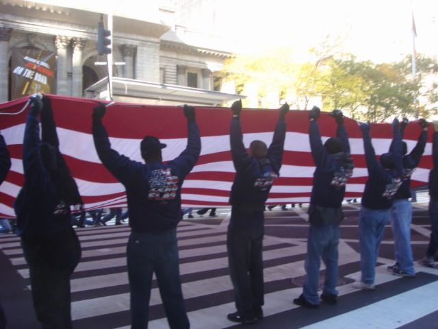 20071111-veterans-day-parade-15-wtc-ground-zero-flag-being-waved.jpg