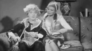 Stan in disguise as Agnes the maid with Thelma Todd in Another Fine Mess
