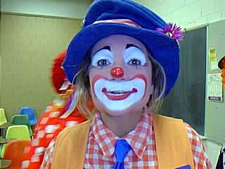 A close-up of the Happi Hippi, now retired from teaching & touring the country, spreading smiles wherever she, her husband & their RV goes. This is a fine example of the Auguste clown make up style.