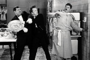 Oliver Hardy and Stan Laurel attacking Billy Gilbert