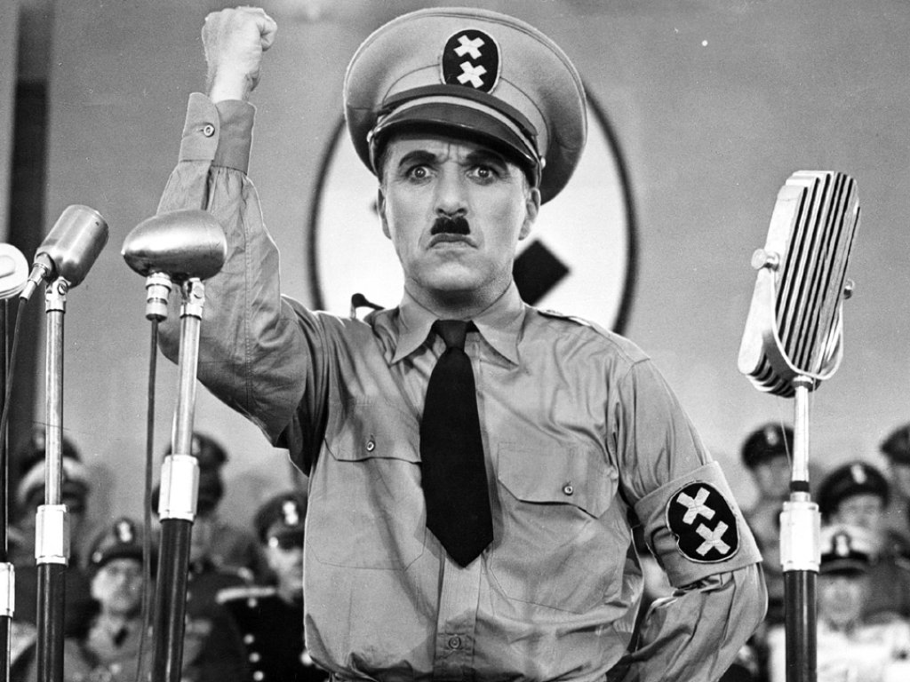 Charlie Chaplin as The Great Dictator, angrily giving a speech