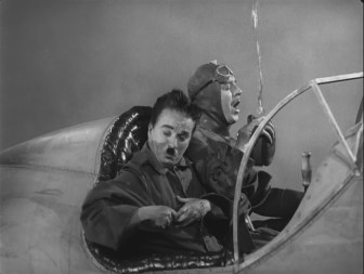 The Great Dictator – Charlie Chaplin as the Jewish barber in an airplane during World War I with Schultz