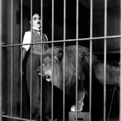 "Charlie Chaplin in ""The Circus"" - United Artists Picture - Lion in cage startles Charlie Chaplin"