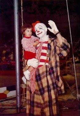 Frosty Little and a child in the circus ring