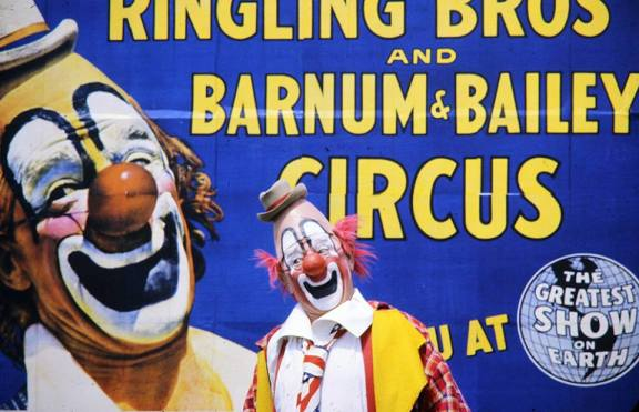 Lou Jacobs in front of Ringling Brothers billboard