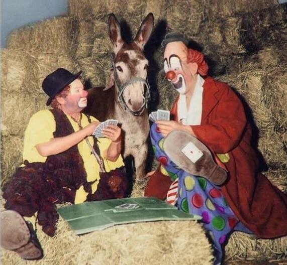 Otto Griebling, a mule, and Lou Jacobs playing cards. I'm betting on the mule ...