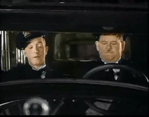 Colorized photo from The Midnight Patrol, starring Stan Laurel and Oliver Hardy