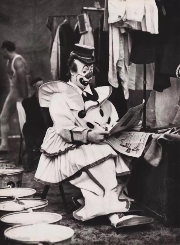 Felix Adler reading newspaper