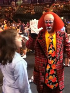 "Genna high-fives Toto at the Ringling Circus' ""Fully Charged"" in Bettendorf, IA in 2012"