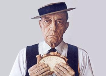 Buster Keaton, later in his career, with his famous deadpan expression and porkpie hat, doing an advertisement for Levy's Jewish Rye.