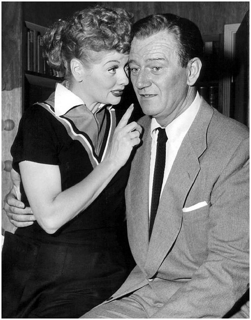 Lucy and her friend, John Wayne - just keep away from those cement footprints