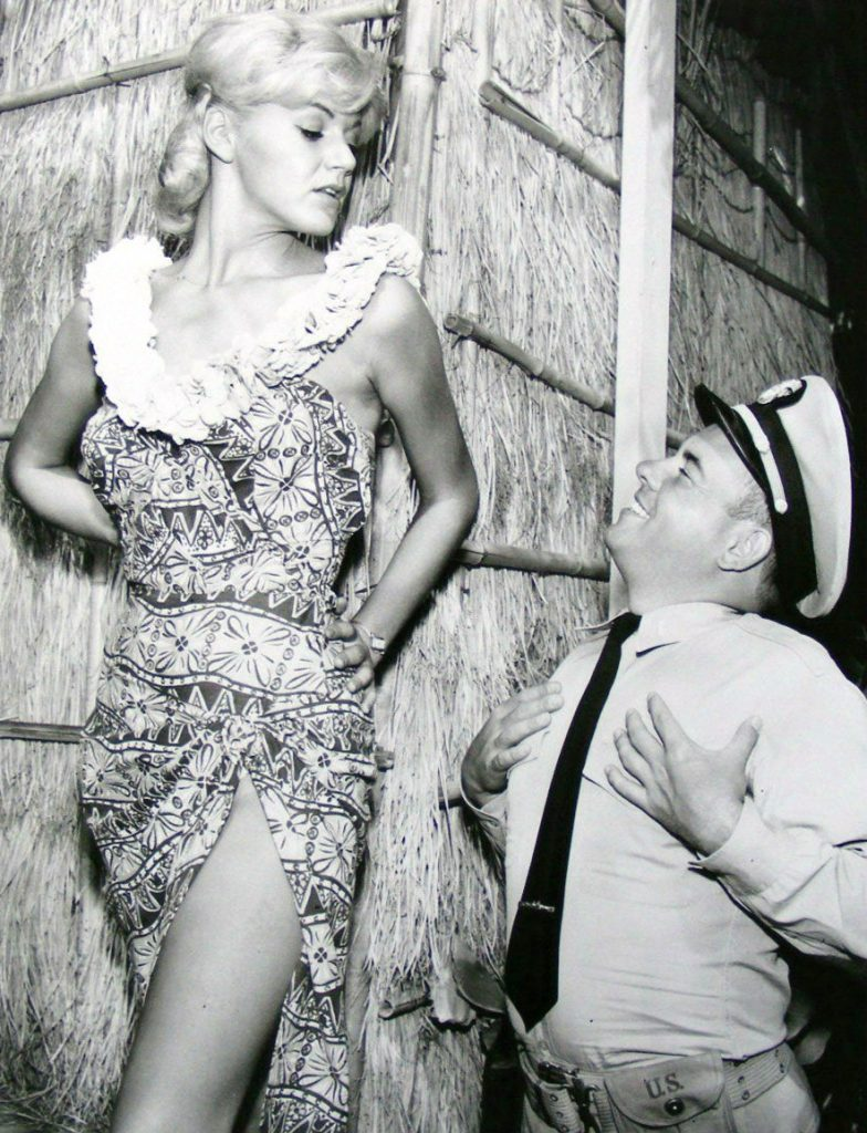 "McHale's Navy. Pictured are Rochelle Rac and Tim Conway as Ensign Parker at ""McHale's Paradise Hotel""."