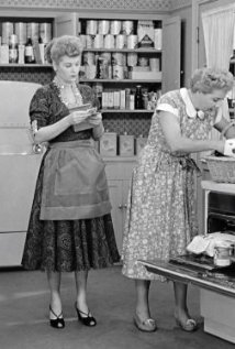 "Lucy and Ethel in the Ricardos kitchen, with the shelves overflowing with their ""inventory"" in The Business Manager"