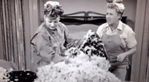 Redecorating the Mertzes' apartment - Lucy and Ethel are pulling the feather stuffing out of the old furniture