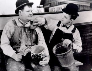 "Oliver Hardy and Stan Laurel painting their boat in ""Towed In a Hole"""