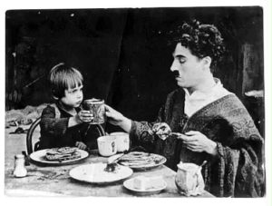 The Kid and Charlie Chaplin eating