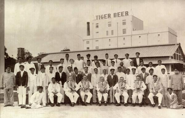 The original brewery on Alexandra Road, circa 1932. Seated are representatives from Heineken and Fraser and Neave