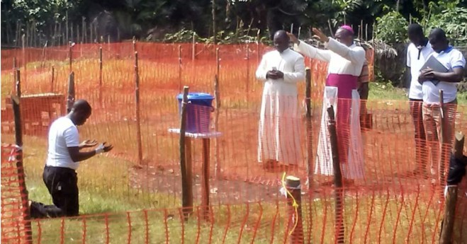 Image of African Bishop Blessing a Vincentian Father with Ebola Impacts Social Networks