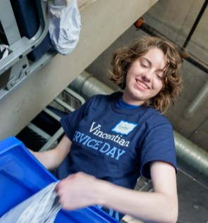 DePaul student Hunter Ansorage helps fold linens at the Pacific Garden Mission, a community refuge for those seeking shelter, food, clothing and medical care in Chicago's South Loop, as part of Vincentian Service Day, Saturday, May 7, 2016. Each year, hundreds of DePaul students participate in community service projects across the city on Vincentian Service Day.