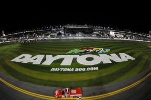 John King, driver of the #7 Red Horse Racing Toyota, celebrates with the checkered flag after winning the NASCAR Camping World Truck Series NextEra Energy Resources 250 at Daytona International Speedway on Feb  23, 2012  Photo - Chris Graythen/Getty Images
