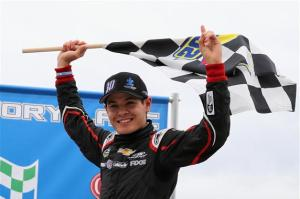 Kyle Larson, driver of the #30 Autism Speaks Chevrolet, celebrates after winning the NASCAR Camping World Truck Series Carolina 200 at Rockingham Speedway on April 14, 2013  Photo - Streeter Lecka/Getty Images
