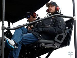 Denny Hamlin on his pit box  Photo - Mike DiNovo, USA TODAY Sports